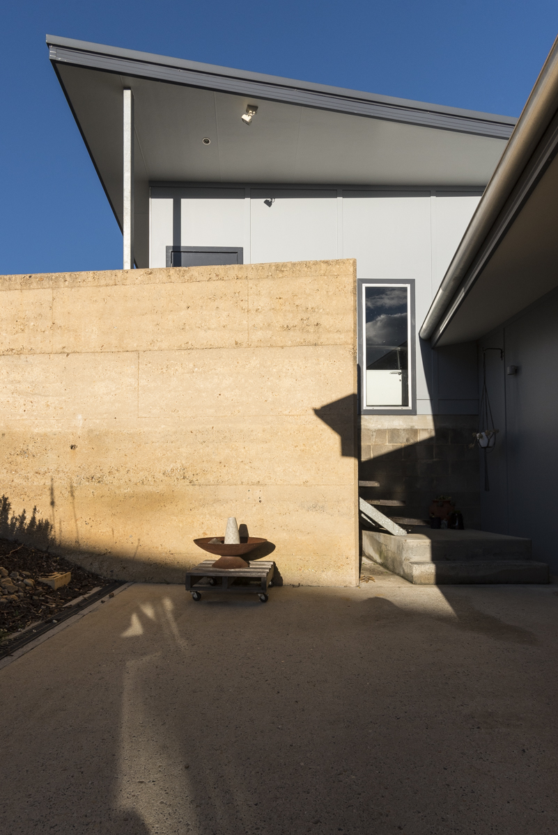 Rammed earth retaining wall to sunken terrace