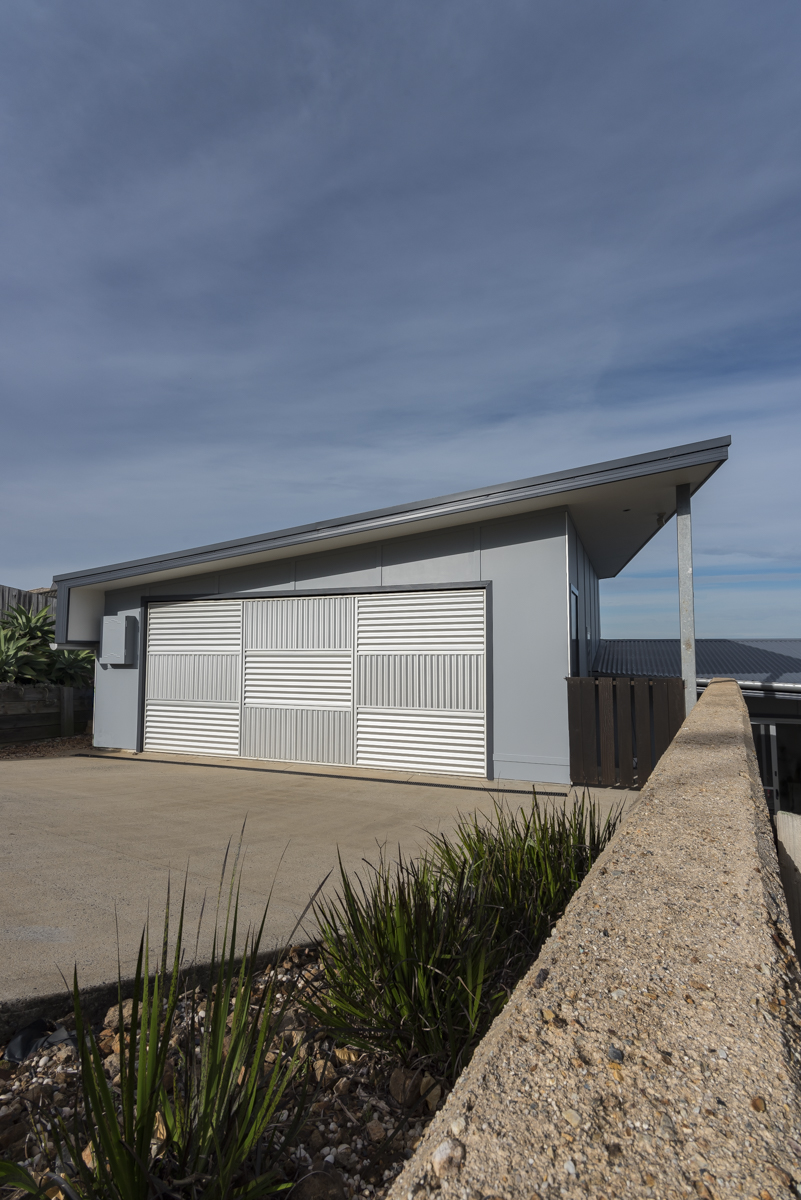 Galvanized steel garage door & skillion roof