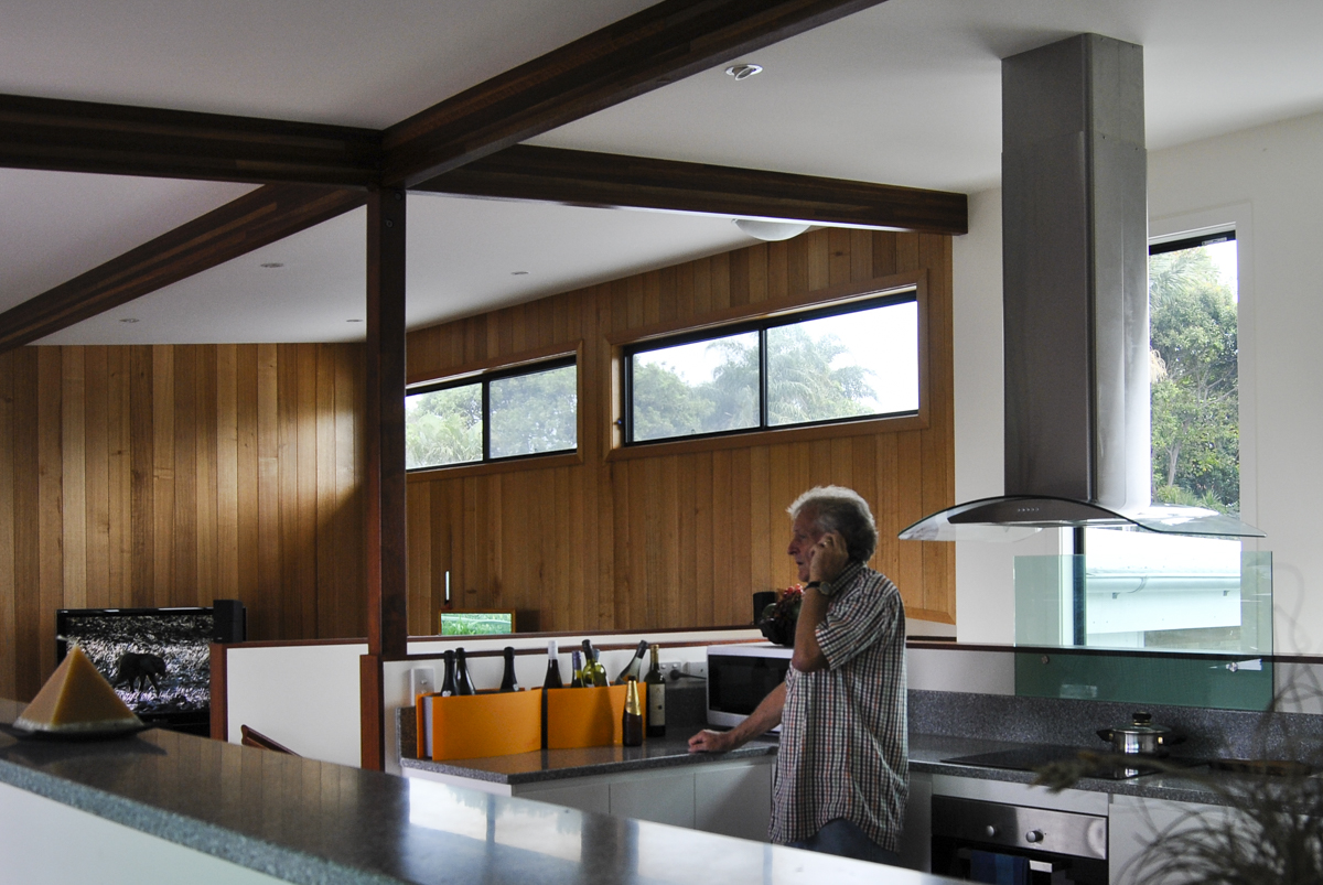 Kitchen and timber lined living room