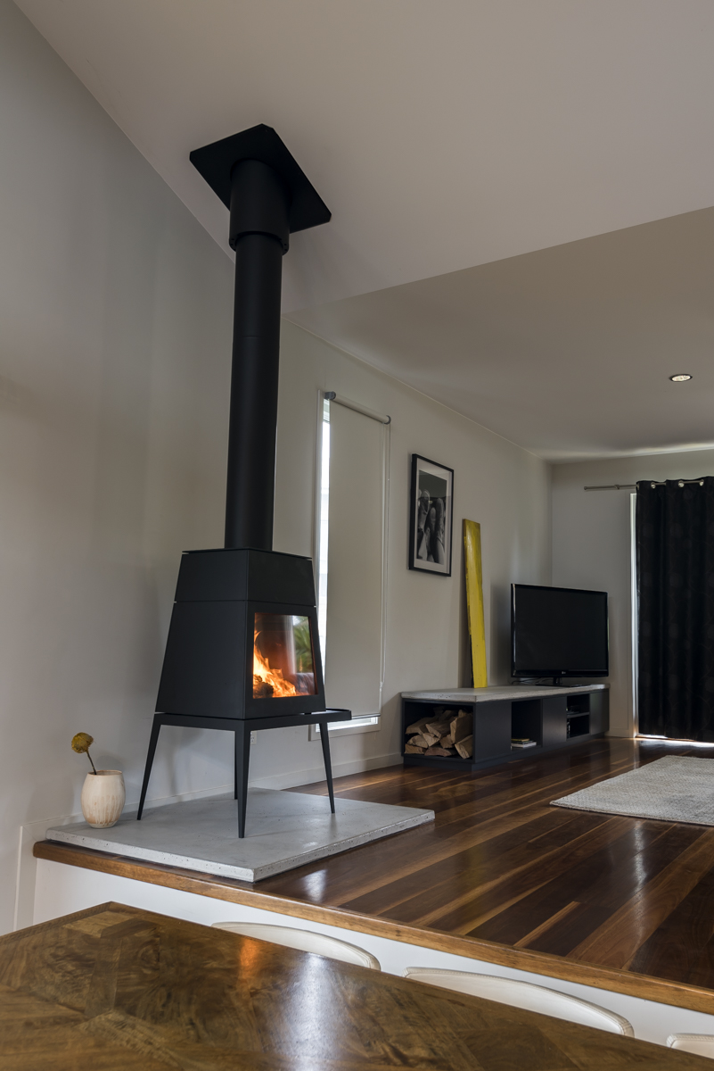 Concrete hearth and entertainment unit in lounge room
