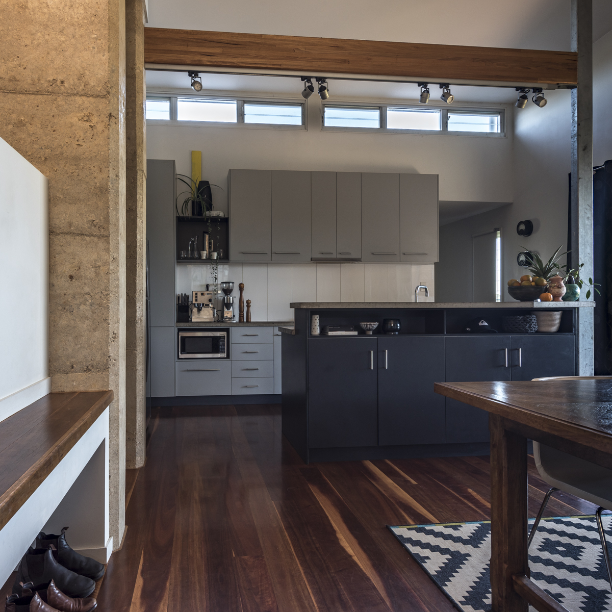 View to kitchen with island bench and timber floors