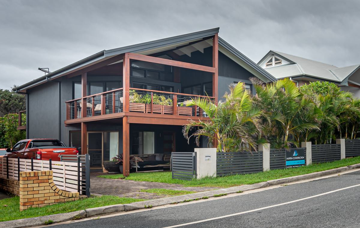 Contemporary exterior with large timber framing