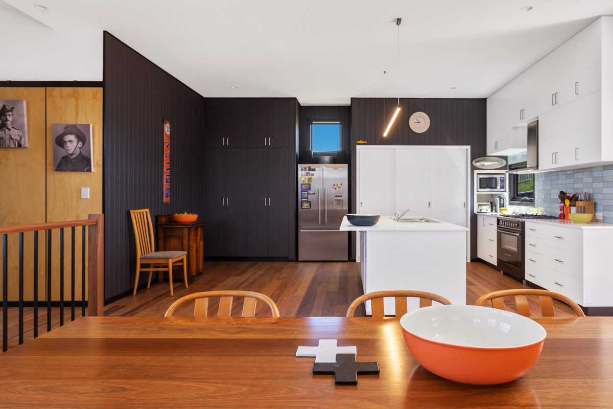 colourful dining room and kitchen with white benches