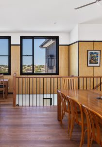 Dining room with timber stair balustrade and plywood