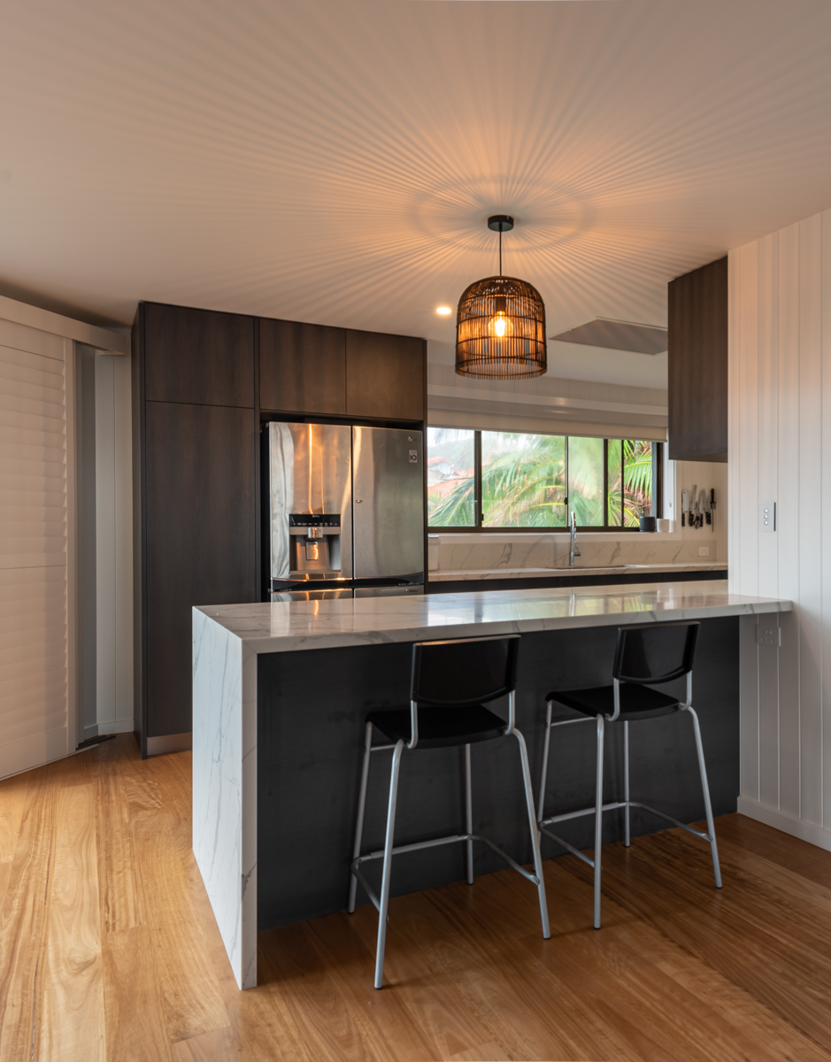 Kitchen with breakfast bar and feature light