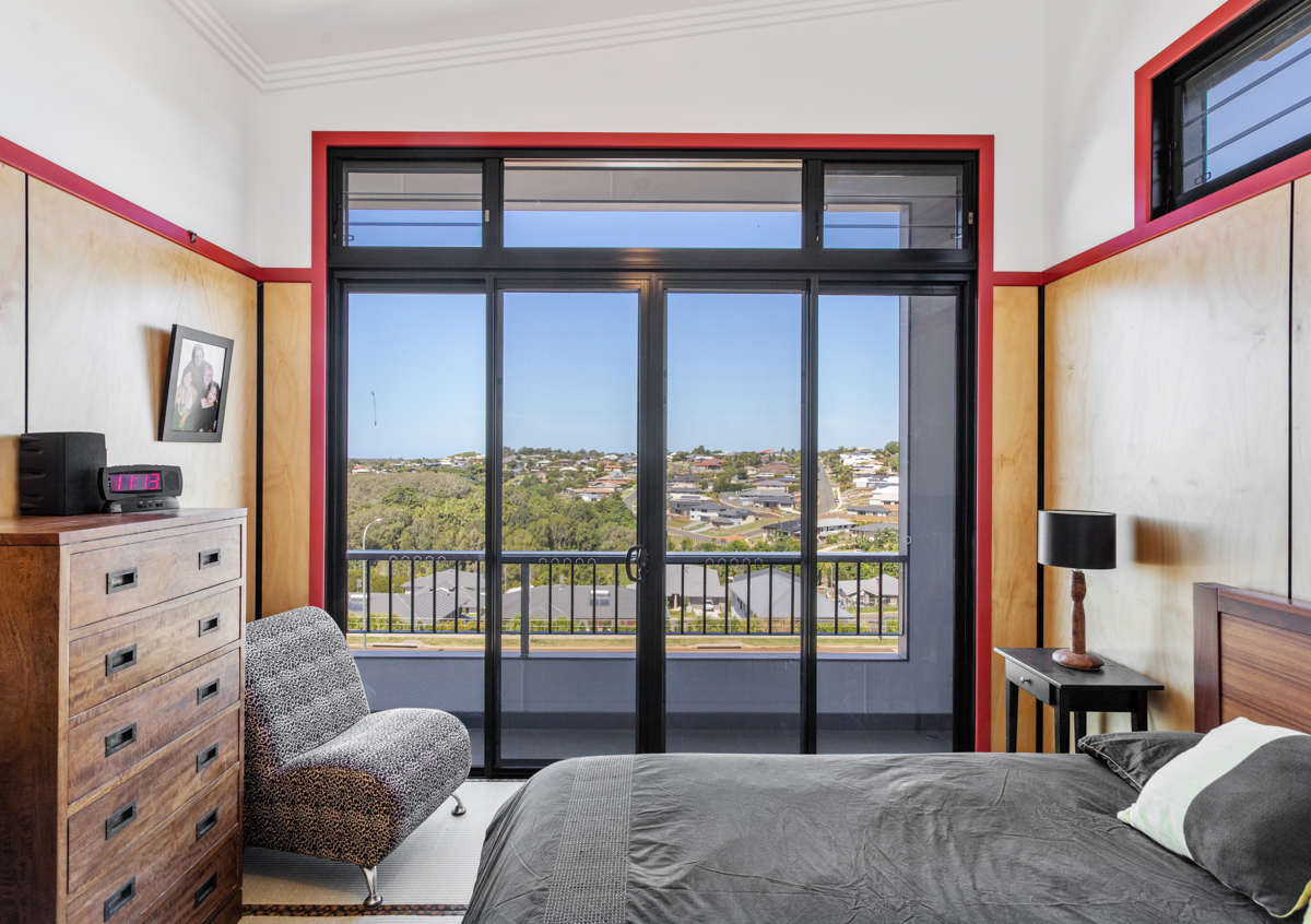 Master bedroom with plywood lining and Juliet balcony