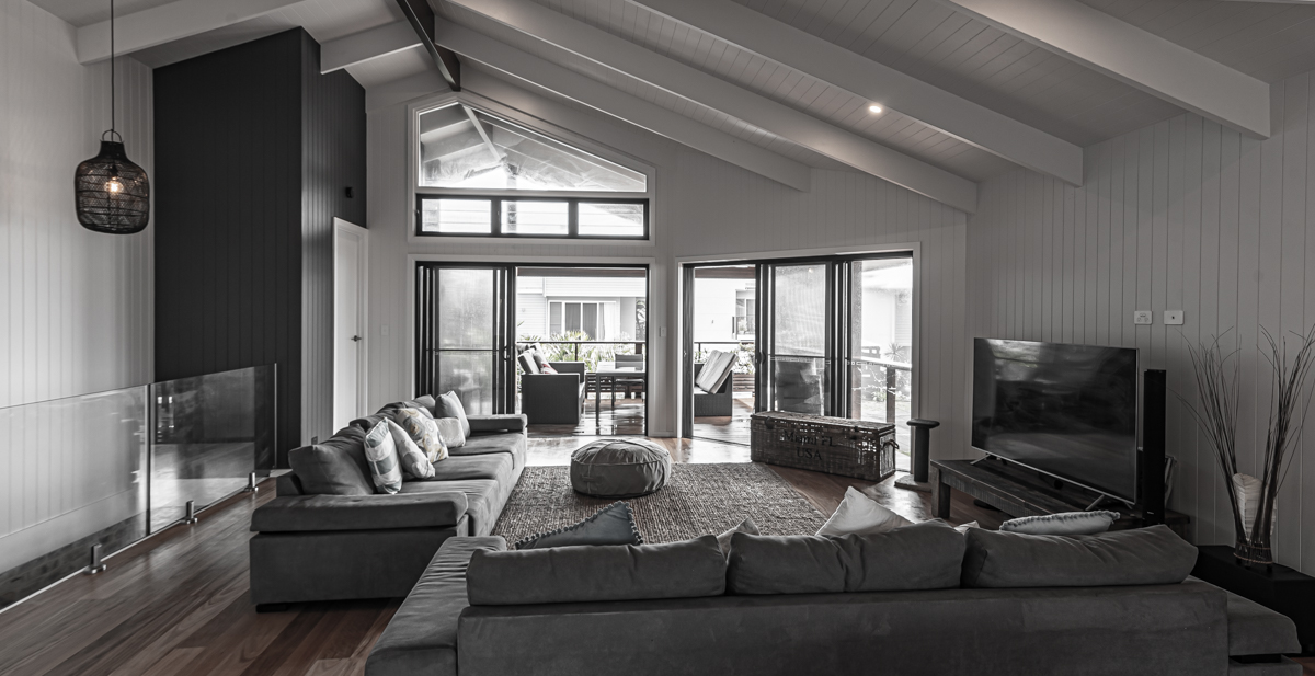 Lounge room with raked ceilings and high-level windows