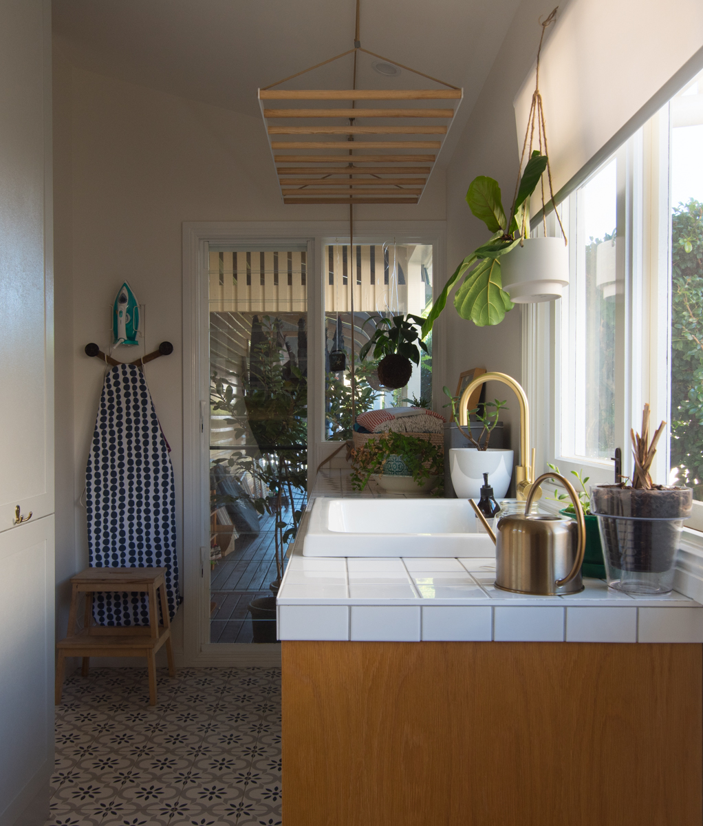 Laundry with tile bench and hanging drying rack